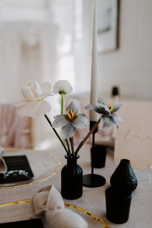 Flower stems in ink wells - modern wedding ideas