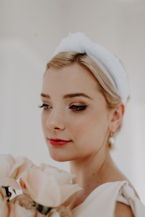 Bride with smokey eye wedding makeup and turban headband