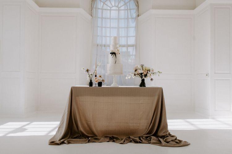 Wedding cake table and modern wedding flowers