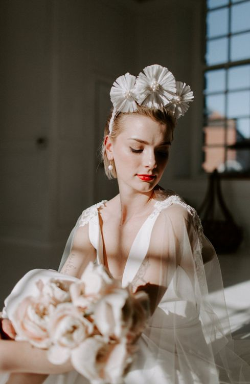 Minimalist bride with bridal crown and red lipstick