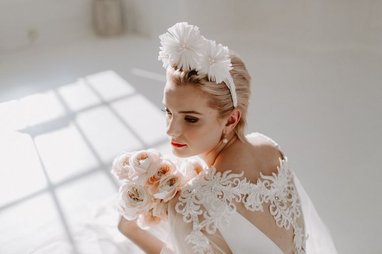 Bride with short hair sitting on the floor with a shadow cast