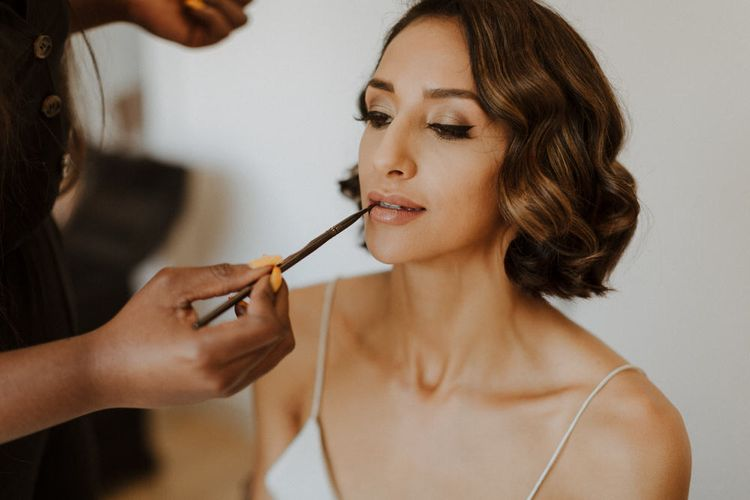 Morning Preparations. Bridal Party. Bride wears dress by Pronovias. Groom wears green velvet blazer from Gieves & Hawkes in this Green And White Luxe, City Wedding. Photography by The Curries.