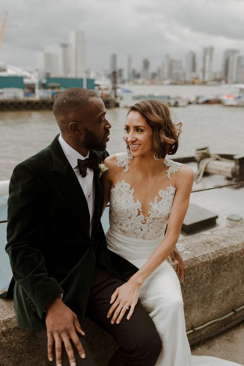 Bride wears dress by Pronovias. Groom wears green velvet blazer from Gieves & Hawkes in this Green And White Luxe, City Wedding. Photography by The Curries.