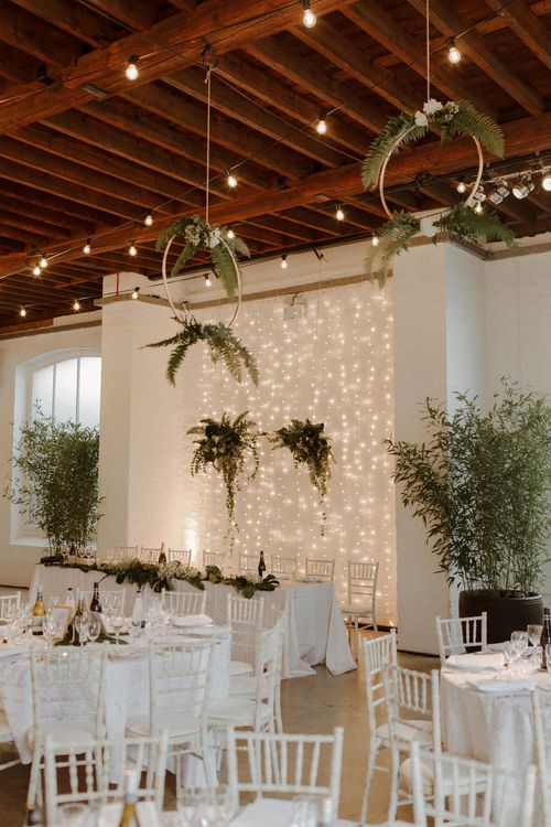 Hoops and Foliage decor for this Green And White Luxe, City Wedding. Photography by The Curries.
