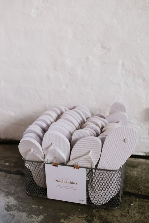 Flip flops for Guests. Modern Warehouse Wedding in London at Trinity Buoy Wharf. Images by Captured by Katrina Photography