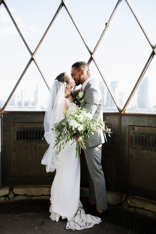 Green Foliage with White Roses and Copper Accents. Modern Warehouse Wedding in London at Trinity Buoy Wharf. Images by Captured by Katrina Photography