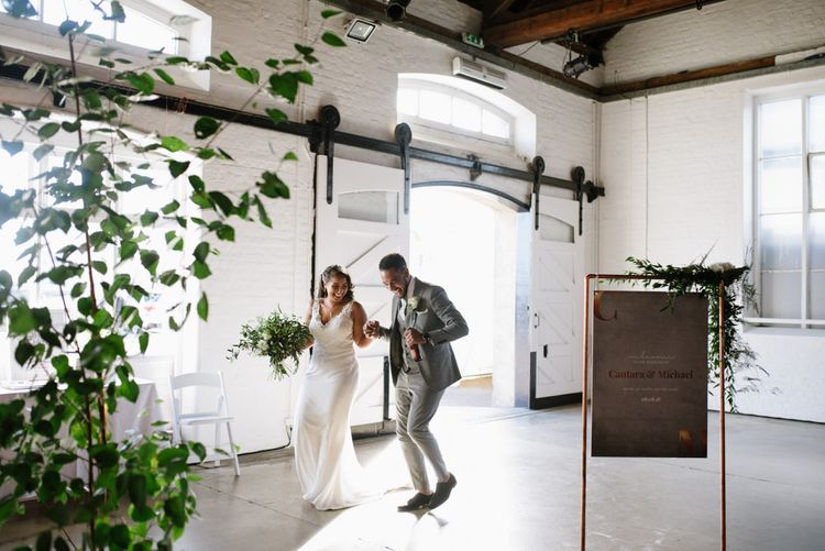 DIY Copper Arbour and Table Plan Stand. Modern Warehouse Wedding in London at Trinity Buoy Wharf. Images by Captured by Katrina Photography