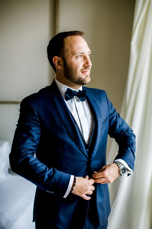 Groom in Blue Scabal Three-piece Wedding Suit with Bow Tie