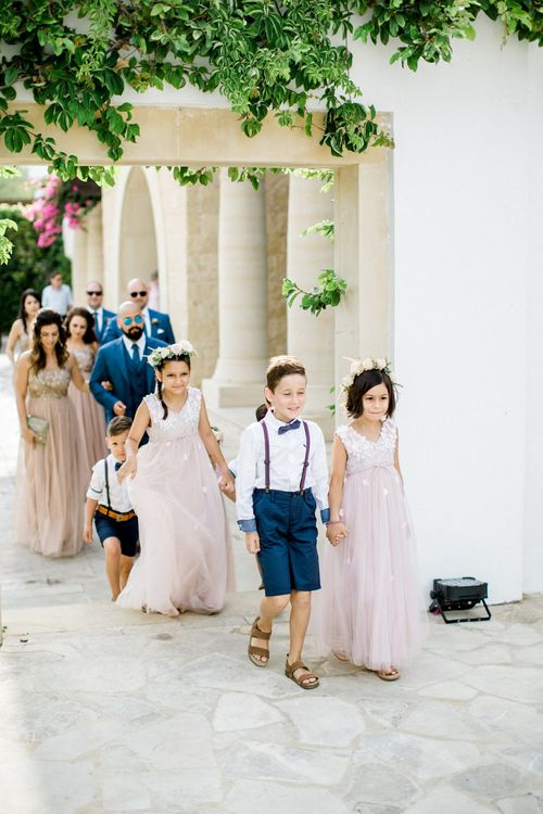 Flower Girls in Pink Dresses and Flower Crowns with Page Boys  in Shorts, Braces and Bow Tie
