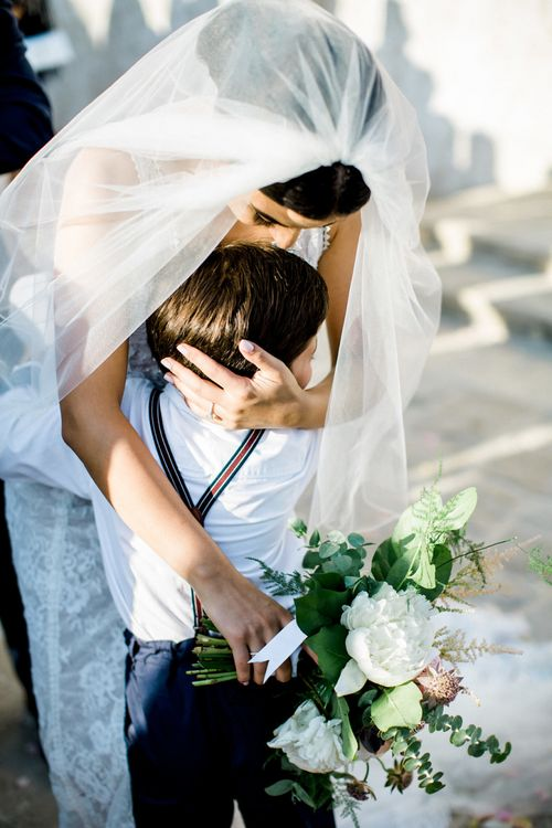 Bride Hugging Page Boy