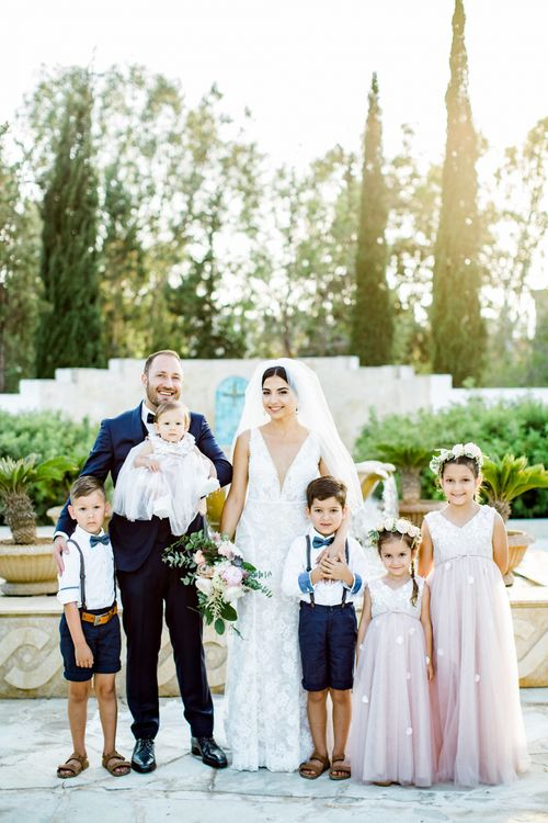 Bride in Lace  Anna Georgina Wedding Dress with Groom in Blue Suit and Flower Girls and Page Boys
