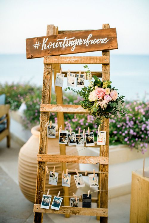 Wooden Polaroid Picture Station with Flowers and Sign