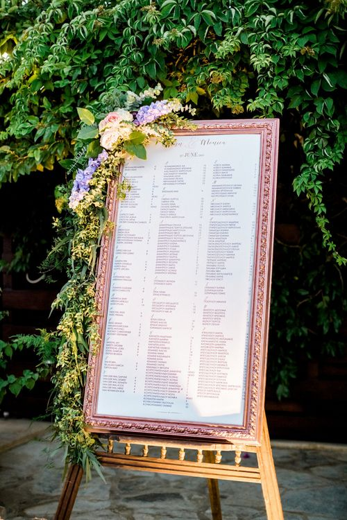 Gold Guilt Frame Seating Chart on Easel with Flowers