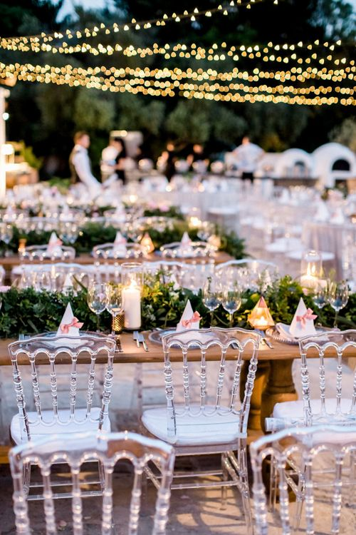 Wedding Reception Ghost Chairs and Twinkling Fairy Lights Wedding Decor