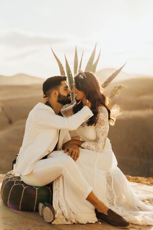 Bride and groom embracing at desert Moroccan wedding