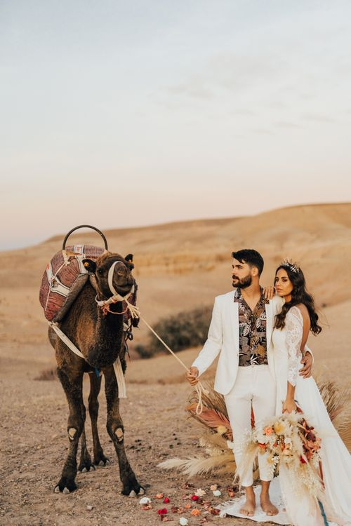 Moroccan wedding in the desert with stylish bride and groom