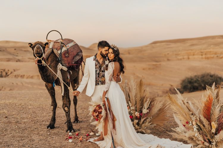 Stylish bride and groom at Morccan wedding with dried flower arrangement  in neutral and rust tones