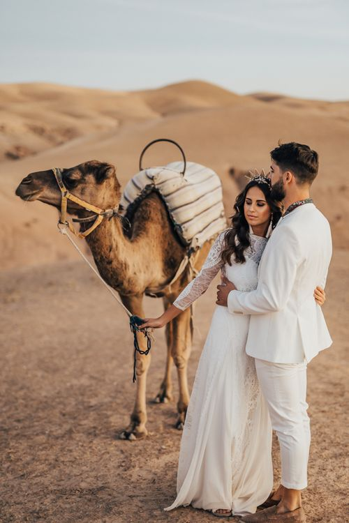 Moroccan wedding with bride and groom holding a camel