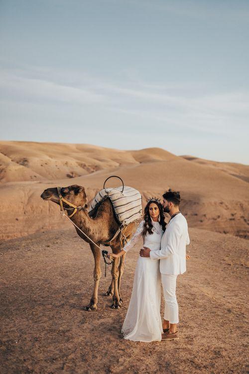 Moroccan desert wedding portrait with camel