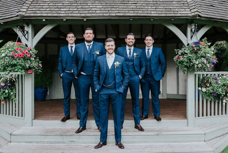 Groomsmen In Blue Suits By Moss Bros. // Image By Michelle Cordner Photography