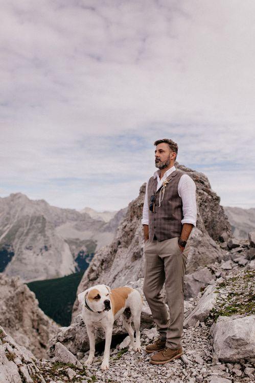 Groom and dog at mountain wedding