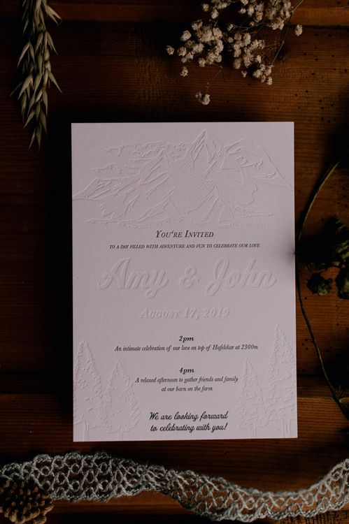 Embossed mountain wedding invitation