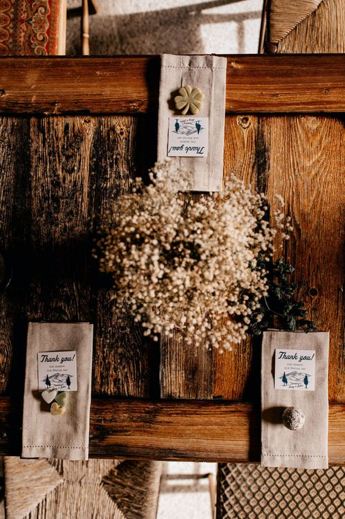 Dried flower centrepiece and wedding favours for mountain wedding reception