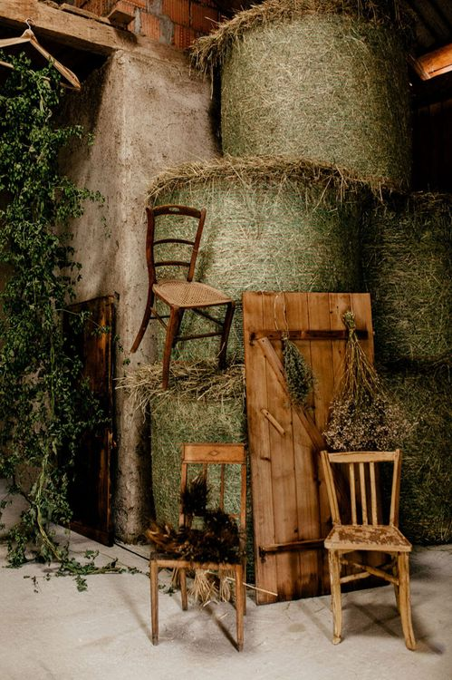 Wooden chairs, and dried flower wedding decor