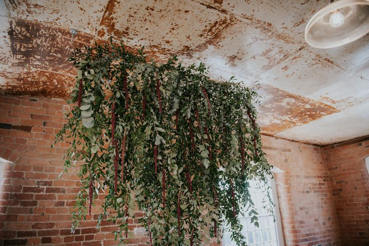 Hanging Greenery Installation | Copper & Greenery Industrial Winter Wedding at The West Mill Derby, Styled by The Vintage House That Could | Rosie Kelly Photography | Jason Lynch Weddings