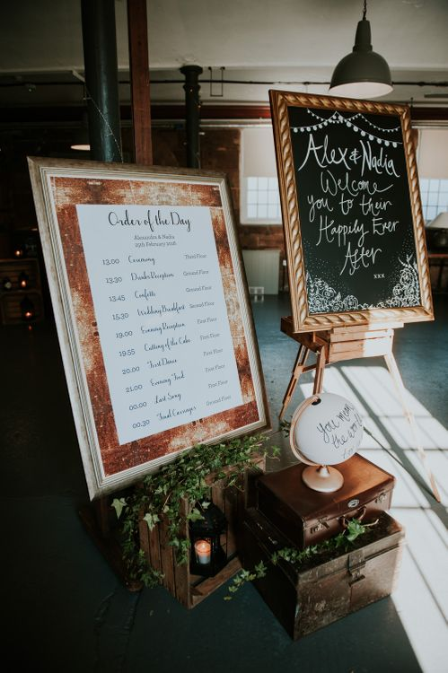 Order of the Day & Chalkboard Welcome Sign with Wooden Crate & Globe Wedding Decor | Copper & Greenery Industrial Winter Wedding at The West Mill Derby, Styled by The Vintage House That Could | Rosie Kelly Photography | Jason Lynch Weddings