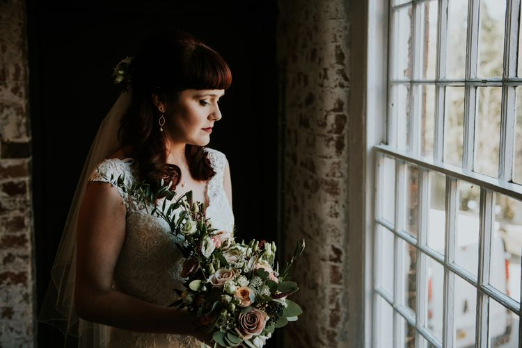 Bride in Wed2B Lace Bridal Gown | Copper & Greenery Industrial Winter Wedding at The West Mill Derby, Styled by The Vintage House That Could | Rosie Kelly Photography | Jason Lynch Weddings