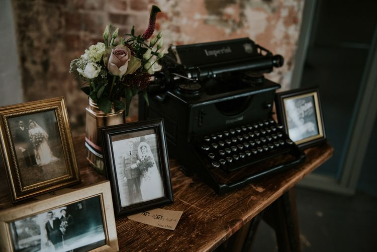 Vintage Typewriter & Family Portraits Wedding Decor | Copper & Greenery Industrial Winter Wedding at The West Mill Derby, Styled by The Vintage House That Could | Rosie Kelly Photography | Jason Lynch Weddings