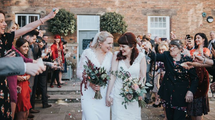 Confetti Exit | Brides in Wed2B Bridal Gowns | Copper & Greenery Industrial Winter Wedding at The West Mill Derby, Styled by The Vintage House That Could | Rosie Kelly Photography | Jason Lynch Weddings