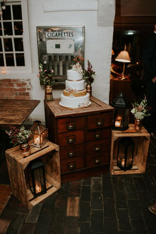 Vintage Dresser Cake Stand & Wooden Crates Wedding Decor | Copper & Greenery Industrial Winter Wedding at The West Mill Derby, Styled by The Vintage House That Could | Rosie Kelly Photography | Jason Lynch Weddings
