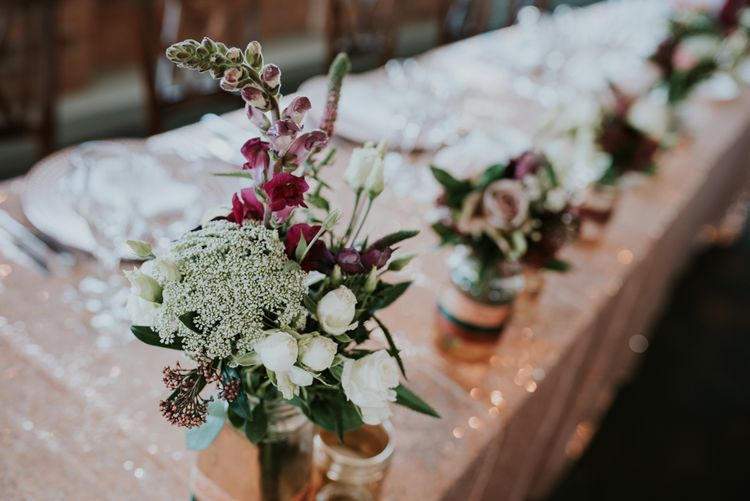 Top Table Wedding Decor Flower Stems in Bottles | Copper & Greenery Industrial Winter Wedding at The West Mill Derby, Styled by The Vintage House That Could | Rosie Kelly Photography | Jason Lynch Weddings