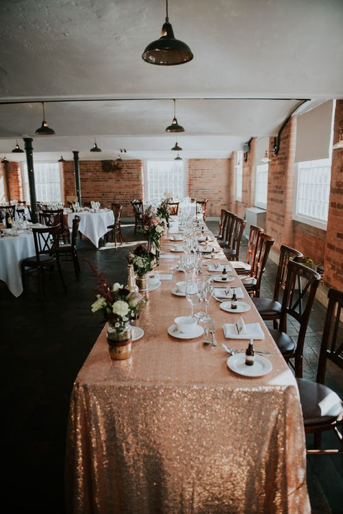 Sequin Table Cloth Top Table Wedding Decor | Copper & Greenery Industrial Winter Wedding at The West Mill Derby, Styled by The Vintage House That Could | Rosie Kelly Photography | Jason Lynch Weddings