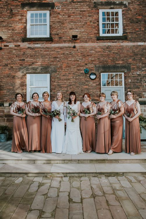 Bridal Party | Bronze ASOS Bridesmaid Dresses | Brides in WED2B Bridal Gowns | Copper & Greenery Industrial Winter Wedding at The West Mill Derby, Styled by The Vintage House That Could | Rosie Kelly Photography | Jason Lynch Weddings