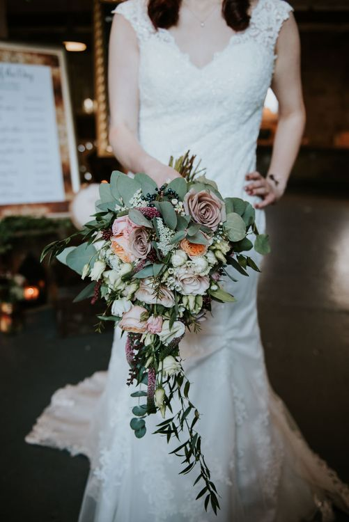 Trailing Winter Bridal Bouquet | Bride in Lace WED2B Bridal Gown | Copper & Greenery Industrial Winter Wedding at The West Mill Derby, Styled by The Vintage House That Could | Rosie Kelly Photography | Jason Lynch Weddings