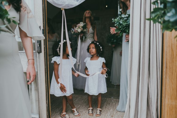 Flower Girls In White Dresses With Balloons // Image By Ross Talling Photography