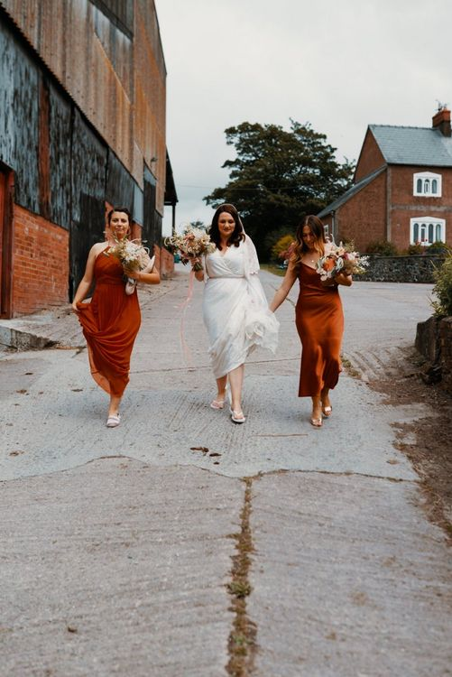 Bride with bridesmaid in Autumn wedding colours dresses