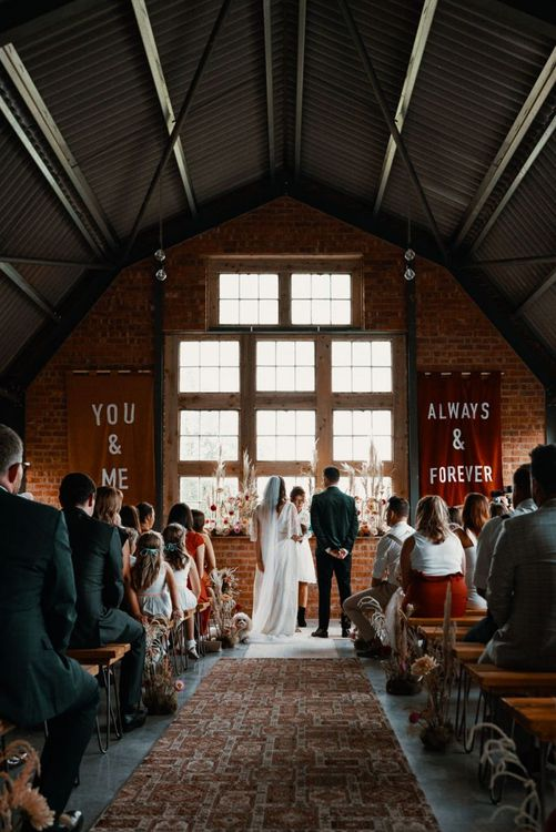 Wedding ceremony at The Giraffe Shed with Autumn wedding colours