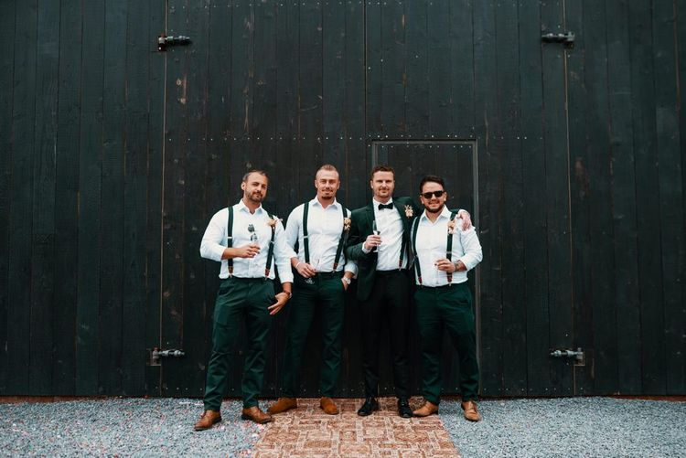 Groom with groomsmen in matching suits