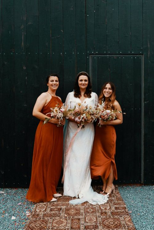 Bride with bridesmaids in Autumn wedding colours dresses