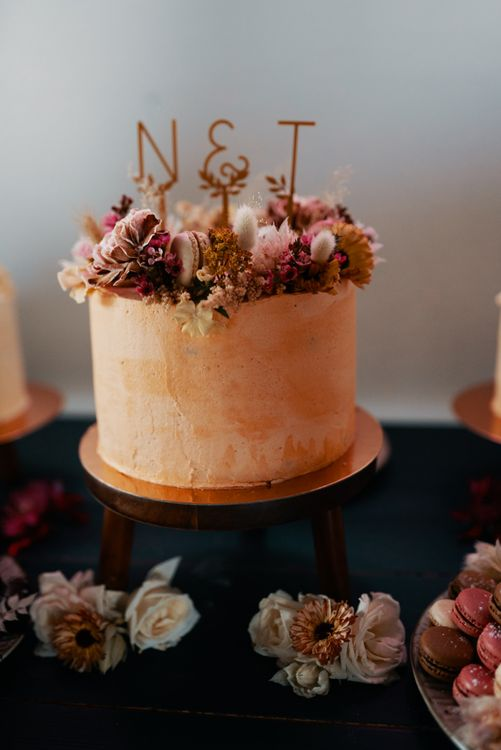 Wedding cake in Autumn wedding colours with dried flower topper