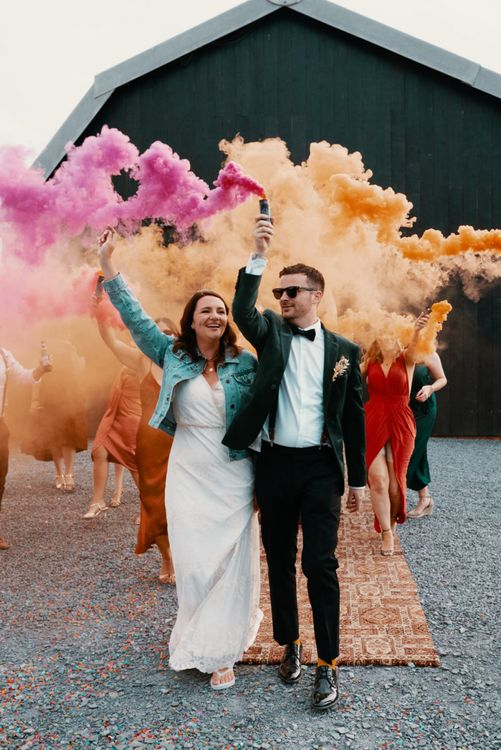 Bridal jacket with smoke bombs in Autumn wedding colours