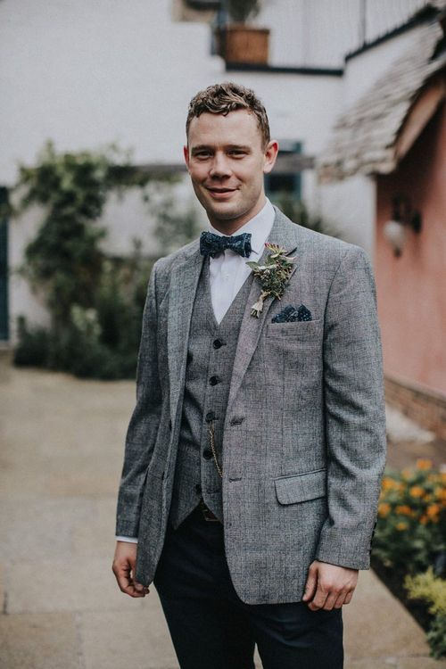 Groom in Grey Empire Outlet Blazer and Waistcoat