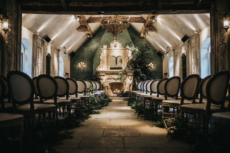 Wedding Ceremony at Le Petit Chateau in Northumberland with Greenery Aisle and Fireplace Decor