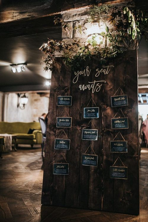 Wooden Your Seat Awaits Table Plan with Gold Hanging Frames