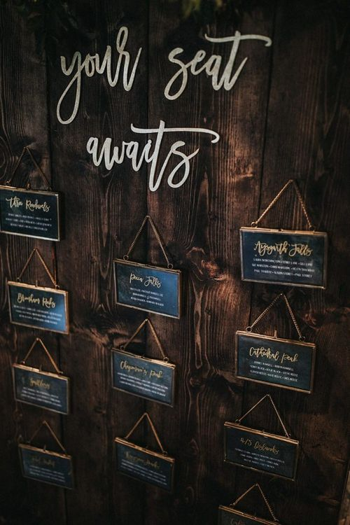 Laser Cut Your Seat Awaits Sign and Wooden Table Plan with Gold Hanging Frames