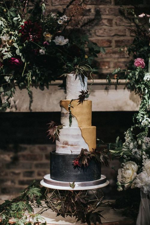 Four Tier Wedding Cake with Black Gold and White Layers